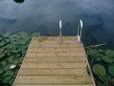 Oak clad jetty with swimming access